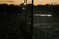 """Spectators and contestants take part in the Fourth of July """"Thrill Show"""" at the Seekonk Speedway in Seekonk, Massachusetts on July 5, 2009.  The Thrill Show features 'Hillbilly Racing', demolition derby, stock racing and fireworks among other events.  Photo by Matthew Healey"""