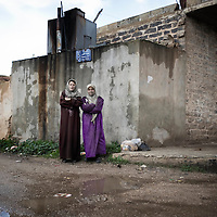 SYRIA - Al Qsair. Two Syrian women stand in the streets of Al Qsair on January 27, 2012. Al Qsair is a small town of 40000 inhabitants, located 25Km south-west of Homs. The town is besieged since the beginning of November and so far it counts 65 dead. ALESSIO ROMENZI