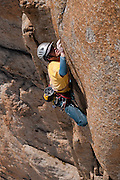 James McHaffie leading the crux pitch of the Voie Petit, Grand Capucin