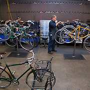 DETROIT, MI - OCTOBER, 30: John Ackley, 51, Production Manager for Bicycles, assembles a bike at the Shinola store in Detroit, Michigan, Thursday, October 30, 2014. (Photo by Jeffrey Sauger)