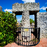 MIAMI, FLORIDA -- July 12, 2015 -- Visitors take in the unusual formations and structures, including the 9 ton rotating gate, made by Edward Leedskalnin at the Coral Castle Museum in Miami, Florida.  (PHOTO / CHIP LITHERLAND)