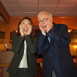 Warren Buffett poses with business students from universities around the country after at lunch at Piccolo Pete's Restaurant in Omaha, Neb., Nov. 11, 2011. Here, Buffett poses with Patricia Pan of Northwestern University's Kellogg School of Management.