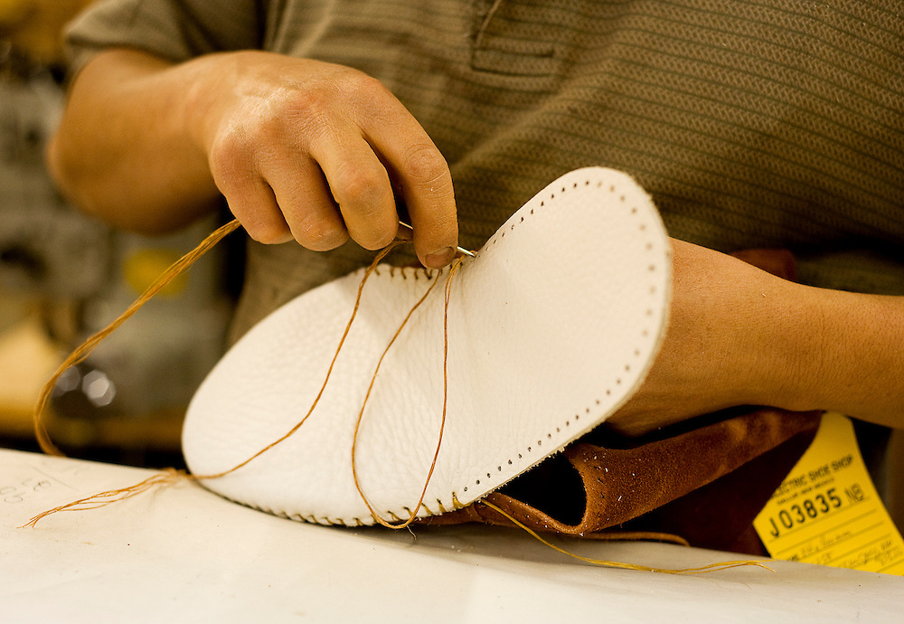 040709  Brian Leddy.Taos Moccasins are assembled by hand.