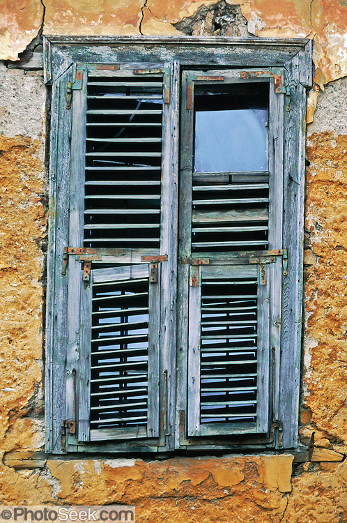 Athens, Greece: old shuttered window, yellow wall