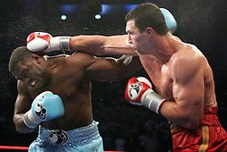 Wladimir Klitschko (r) and Samuel Peter (l) trade punches during their fight Saturday night at Boardwalk Hall in Atlantic City, NJ.  Klitschko won via 12 round unanimous decision.