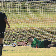 Newark FC Goalkeeper Clayton Hansen (1) attempts to make a diving save in the first half of a regular season soccer match between Newark and Delcastle Thursday, Oct. 22, 2015 at Delcastle in Wilmington.