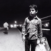 Young Churro vendor on bridge over Tijuana River.  1992