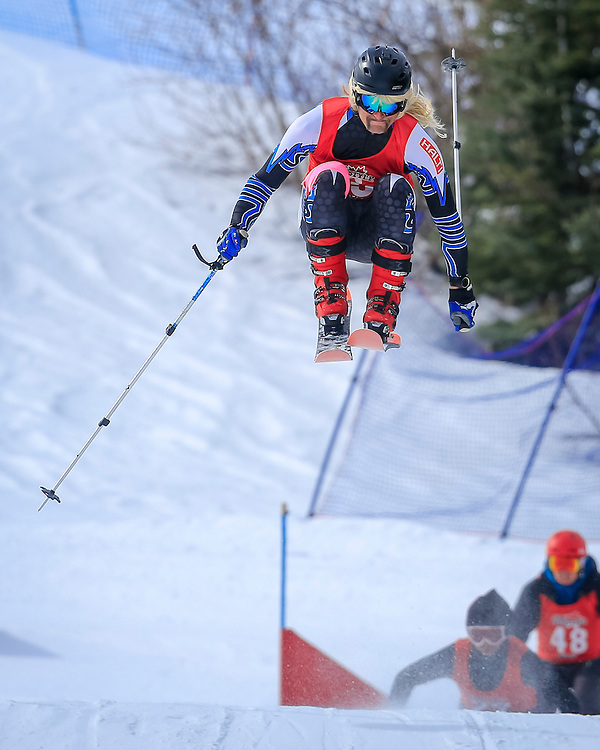 Sam Reimer gaps the rollers on his way to win the final of the open men's skiercross.