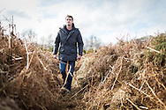 Television historian Dan Snow explores an overgrown trench in a practice battlefield, where thousands of troops trained before embarking for the battlefields of Europe during World War One. The trench system was been discovered by chance on the Browndown Ministry of Defence site in Gosport, Hampshire, England. March 6, 2014. AFP PHOTO / CHRIS ISON.