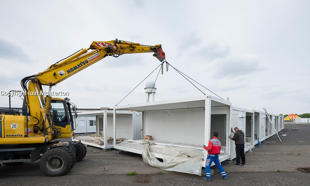 "Berlin, Germany, 6 May 2017. Temporary accomodation  for asylum seekers being erected at ""Tempohome"" in grounds of former Tempelhof Airport in Berlin , Germany."