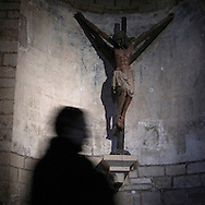 Crucified Jesus Christ in Puente La Reina. Navarre . Spain . The WAY OF SAINT JAMES or CAMINO DE SANTIAGO following the French Route, between Saint Jean Pied de Port and Santiago de Compostela in Galicia, SPAIN. Tradition says that the body and head of St. James, after his execution circa. 44 AD, was taken by boat from Jerusalem to Santiago de Compostela. The Cathedral built to keep the remains has long been regarded as important as Rome and Jerusalem in terms of Christian religious significance, a site worthy to be a pilgrimage destination for over a thousand years. In addition to people undertaking a religious pilgrimage, there are many travellers and hikers who nowadays walk the route for non-religious reasons: travel, sport, or simply the challenge of weeks of walking in a foreign land. In Spain there are many different paths to reach Santiago. The three main ones are the French, the Silver and the Coastal or Northern Way. The pilgrimage was named one of UNESCO's World Heritage Sites in 1993. When there is a Holy Compostellan Year (whenever July 25 falls on a Sunday; the next will be 2010) the Galician government's Xacobeo tourism campaign is unleashed once more. Last Compostellan year was 2004 and the number of pilgrims increased to almost 200.000 people.