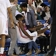 Delaware 87ers Head Coach Kevin Young and Athletic trainer Christina Kennedy help carry Forward Malcolm Lee (14) to the bench after suffering from severe leg cramps in the first half of a NBA D-league regular season basketball game between the Delaware 87ers and the Westchester Knicks (New York Knicks) Sunday, Dec. 28, 2014 at The Bob Carpenter Sports Convocation Center in Newark, DEL
