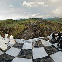 These are 18 inch tall chess pieces on a 9 x 9 foot board that was spray painted onto a silver tarp.  This image is a stitch from 130+ images that were taken in succession from a tripod mounted Nikon D300s and merged together using a program called PTGui.