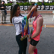 ElizabethSwierzbinski (2015) of Wilmington, DE., receives her medal after finishing the 13th Annual Discover Bank Delaware Marathon Sunday, May 8, 2016, at Tubman Garrett Riverfront Park, in Wilmington Delaware.