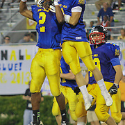 Blue cornerback Jesse June (1) of the Salesianum School celebrates with teammate Sterlin Johnson (2) of The Tatnell School after intercepted a pass in the FOURTH-QUARTER of the 58th Annual DFRC Blue-Gold AllStar Football game Saturday, June. 22, 2013, at Delaware Stadium in Newark DE.