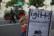 "Several tens of thousands people demonstrated today (05.09.2009) in Berlin against german nuclear policy in the forefont of the general german parliament election on 27.september 2009. The protesters had been accompanied by hundreds of tractors which farmers from norther germany have driven into the capitals center. The protest take place while Germany faces different scandals of inadequate handling of nuclear waste in ""Asse"" and manipulated documents to implement Gorleben as a final storage for nuclear waste."