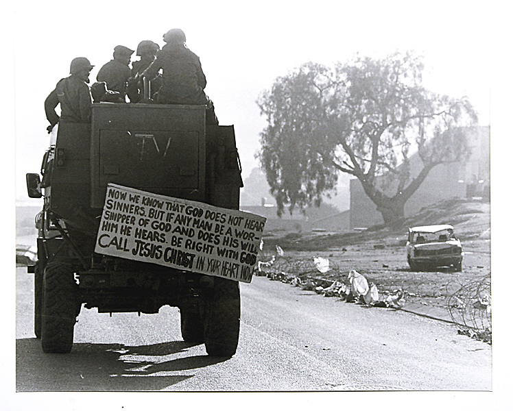 Copy of a vintage print by Joao Silva. £@ battalion soldiers with signs from a revivalist church they had 'borrowed' while patrolling Alexandra township.