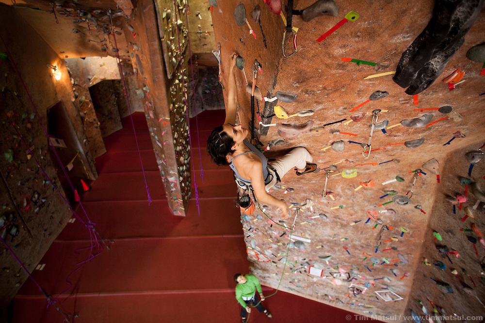 Climbers at the Stone Gardens climbing gym, Seattle, Washington, USA. Sport climbers and boulderers at Stone Gardens, an indoor climbing in Seattle, Washington.