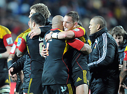 Chiefs Sona Taumalolo, left and Aaron Cruden hug after they defeated the Crusaders in the Super 15 Rugby semi final match, Waikato Stadium, New Zealand, Friday, July 27, 2012. Credit:SNPA / Ross Setford