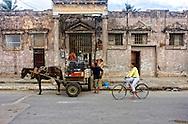 Horse and wagon delivering gravel in Moron, Ciego de Avila, Cuba.