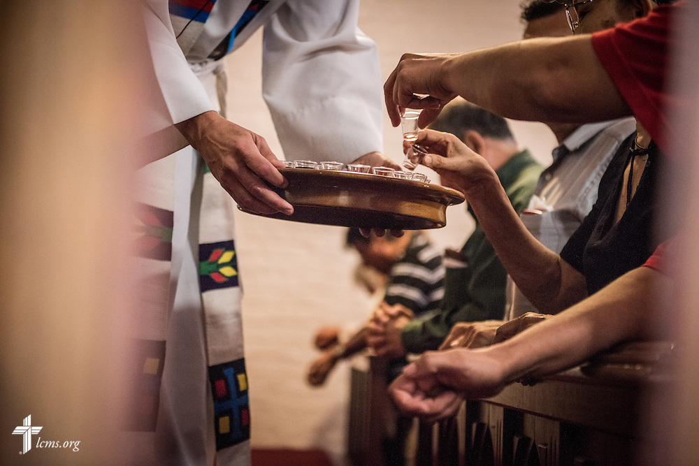 Parishioners receive Communion at El Calvario Lutheran Church on Sunday, April 17, 2016, in Brownsville, Texas. LCMS Communications/Erik M. Lunsford
