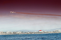 22 December 2016:  Inaugural Breitling Huntington Beach Airshow views over the pacific ocean looking back on the shore along Pacific Coast Highway at the pier.