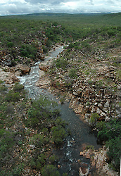 Water gushes down a creek in  Talbot Gorge on Mt Hart Station on the Kimberley's Gibb River Road.  During the wet the station can be isolated for up to 6 months.