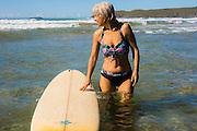 Woman surfer, Sandy Beach, Coffs Harbor, NSW, Australia