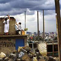 Building a second floor on a barrio home in Mexico City.
