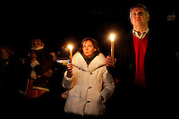 Anne Vogel (C) of Sandy Hook, Connecticut and Marshall Odeen of Ridgefield, Connecticut hold candles outside Saint Rose of Lima Roman Catholic Church in Newtown, Connecticut as part of a candlelight vigil  following a shooting that left at least 26 people dead including 18 children at the Sandy Hook School earlier in the day on December 14, 2012.  A gunman opened fire inside inside Sandy Hook Elementary School early Friday morning where his mother worked.  The suspect 20-year-old Adam Lanza, reportedly killed himself following the shooting rampage inside the school.  This is the worst school shooting in the country's history.  UPI/Matthew Healey