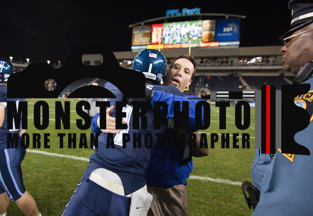 11/19/11 Chester PA: Head Coach K.C. Keeler gets a hug from Villanova CB James Pitts #1 at center field after the game Saturday, Nov. 19, 2011 at PPL Park in Chester PA...With the win over Villanova and other results around the nation, The #15 Rank Delaware Fightin' Blue Hens will have to wait until Sunday for a NCAA FCS playoff invite when the 20-team field will be announced Sunday, Nov. 20, 2011 at 10 a.m. on ESPNU...Special to The News Journal/SAQUAN STIMPSON