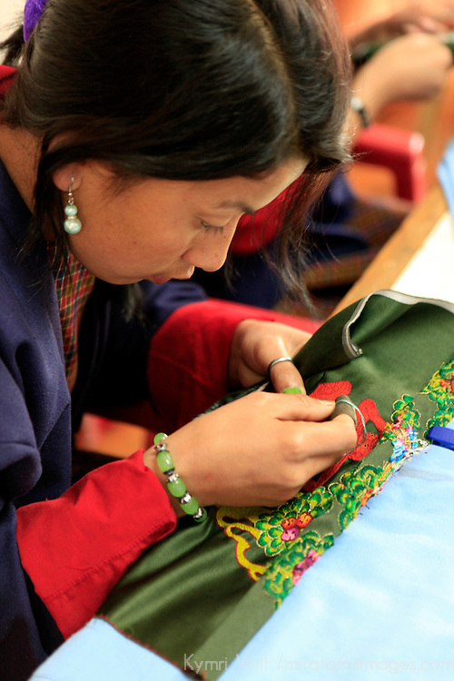 Asia, Bhutan, Thimpu. Embroidery Student at the National Institute for Zorig Chusum, or traditional arts and crafts.