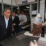 Egyptian Presidential candidate Amr Moussa tours a cookie and chip factory in the Nile Delta region near the city of Banha May 5, 2012. Moussa has made the economy one of his campaign's central emphasis, promising to return it to strong growth in a short time frame through support for industry and trade.