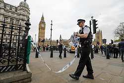 © Licensed to London News Pictures. 27/04/2017. London, UK. A police cordon on Whitehall near the Houses of Parliament in London, shortly after a man was arrested carrying a bag full of knives, on Whitehall in Westminster, central London. Photo credit: Tolga Akmen/LNP