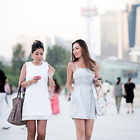 Baku, Azerbaijan, 25 July 2012<br /> Two Azeri women walk in the Baku boulevard, a promenade parallel to the seafront.<br /> Baku is the capital and largest city of Azerbaijan, as well as the largest city on the Caspian Sea and of the Caucasus region. It is located on the southern shore of the Absheron Peninsula, which projects into the Caspian Sea. <br /> The city consists of two principal parts: the downtown and the old Inner City (21.5 ha). <br /> Baku's urban population at the beginning of 2009 was estimated at just over two million people. Officially, about 25 percent of all inhabitants of the country live in the metropolitan city area of Baku.<br /> Photo: Ezequiel Scagnetti