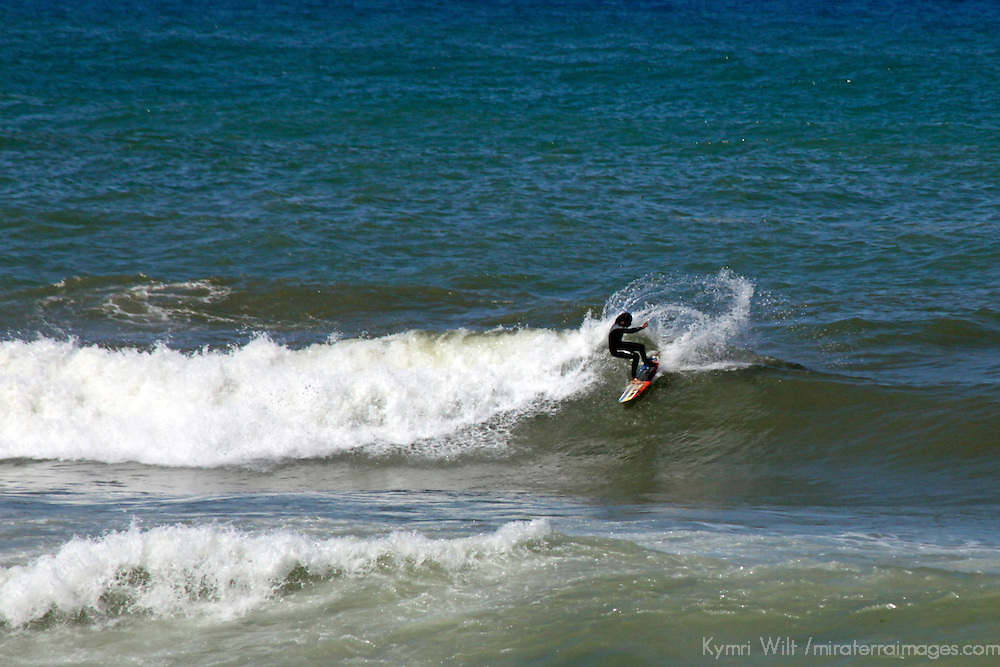 Africa, Morocco, Rabat. Surfer in the waves off Rabat's coast.