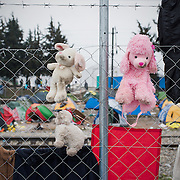 Cuddly toys left on a fence in the transit camp of Idomeni, Greece. <br /> <br /> Thousands of refugees are stranded in Idomeni unable to cross the border. The facilities are stretched to the limit and the conditions are appalling.
