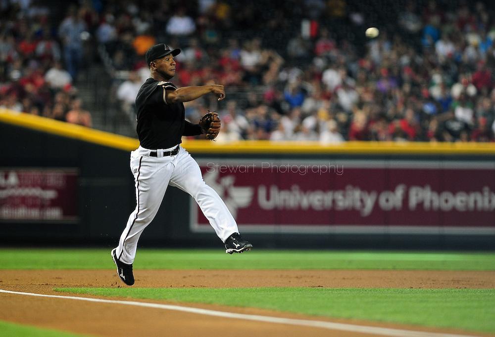Jun. 18 2011; Phoenix, AZ, USA; Arizona Diamondbacks third basemen Melvin Mora (4) throws the force out at first base during the first inning against the Chicago White Sox at Chase Field. Mandatory Credit: Jennifer Stewart-US PRESSWIRE.
