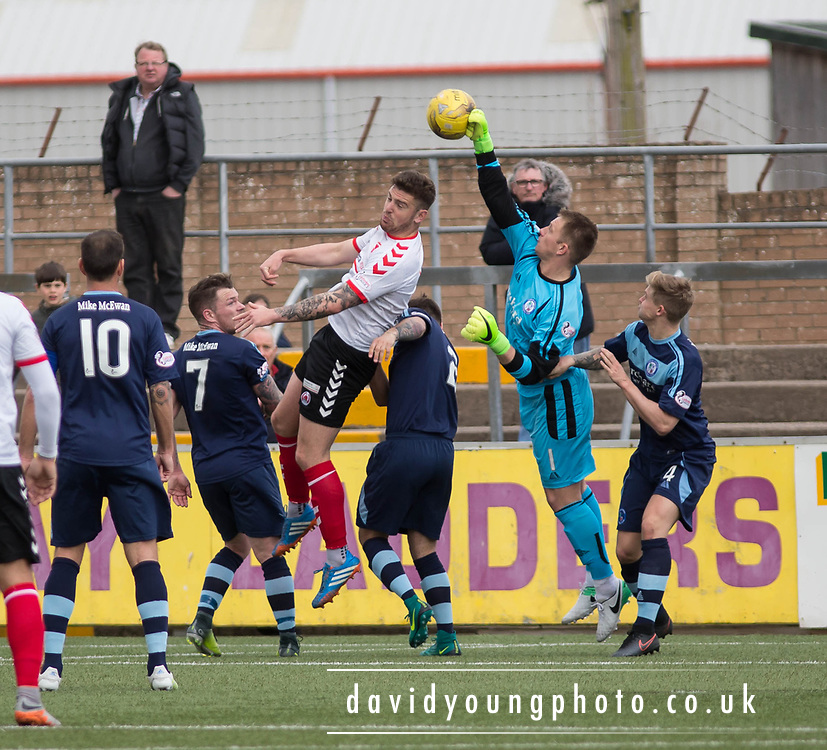 Forfar's Grant Adam punches clear while Clyde's (on loan from Dundee) central defender Kerr Waddell challenges during Forfar's 3-0 win over Clyde in SPFL League Two  at Station Park, Forfar, Photo: David Young<br /> <br />  - &copy; David Young - www.davidyoungphoto.co.uk - email: davidyoungphoto@gmail.com