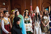 The contestants wait for the judging of the traditional dance to see which women will lead with their countries dance in the final show.