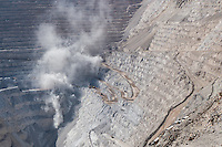 """Chuquicamata, or """"Chuqui"""" as it is more familiarly known, is by excavated volume the biggest open pit copper mine in the world, located in the north of Chile, just outside of Calama, 215 km northeast of Antofagasta and 1,240 km north of the capital, Santiago. The mine is owned and operated by Codelco, a Chilean state enterprise, since the Chilean nationalization of copper in the late 1960s and early 1970s. Its depth of 850 metres (2,790 ft) makes it the second deepest open-pit mine in the world (after Bingham Canyon Mine in Utah, USA)."""