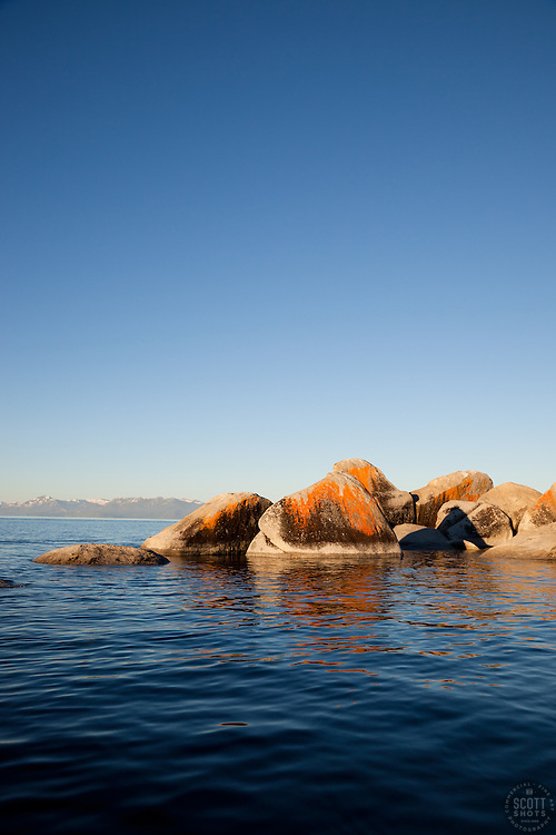 """Boulders on Lake Tahoe 16"" - These orange, black, and grey boulders were photographed in the early morning near Speedboat Beach, Lake Tahoe."