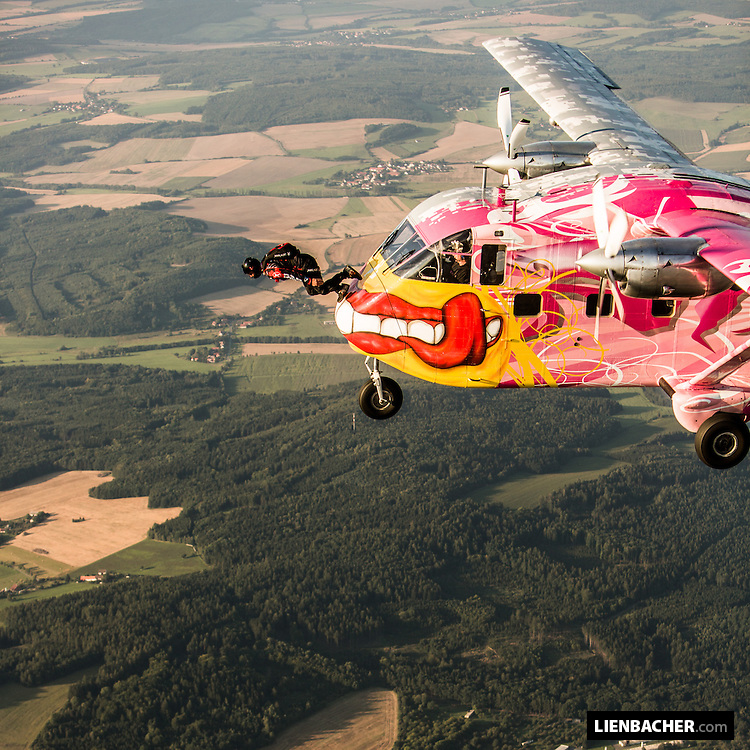 Wuzi Wagner is perfoming his signature stunt. The plane ride on the nose of a SC7 skyvan
