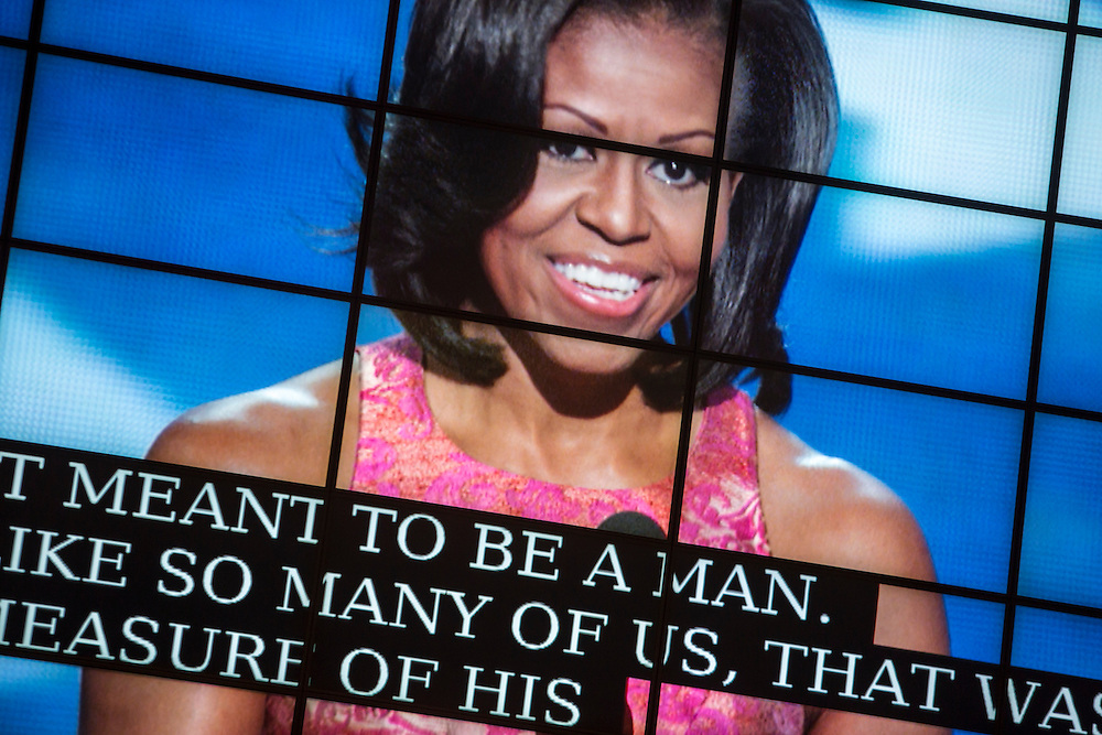 First Lady Michelle Obama is shown on a television screen as she speaks at the Democratic National Convention on Tuesday, September 4, 2012 in Charlotte, NC.