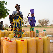 A woman being interviewed at a well refurbished by WaterAid in the village of Gadirga in the Commune of Soukoukoutan in the Dosso Region of Niger on 23 July 2013.