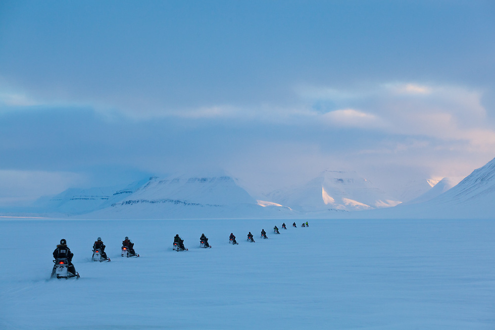 UNIS students travel up Sassendalen, Svalbard on a class field trip by snowmobile to Rabotbreen.