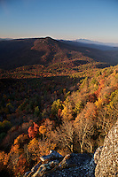 Fall Colors adorn the trees between Table Rock Mountain and Hawksbill Mountain in the Pisgah National Forest, North Carolina. Photo made on the rocky outcropping just above Devil's Cellar