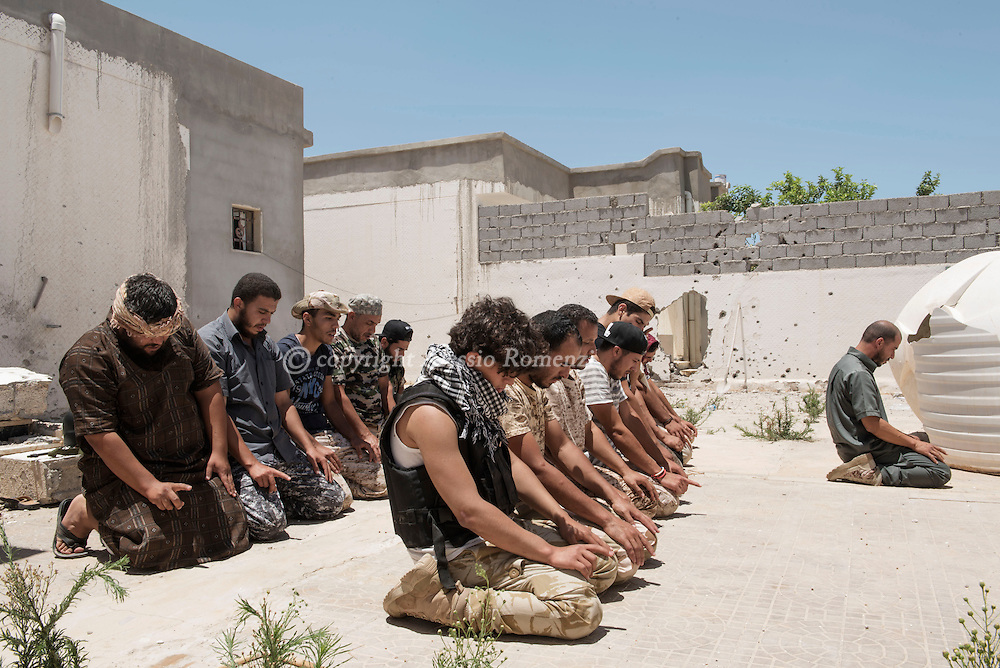 Libya: Libya's Government of National Accord's (GNA) fighters pray in 700 neighbourhood in Sirte still under ISIS control. Alessio Romenzi