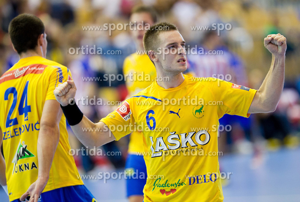 Gasper Marguc of Celje celebrates during handball match between RK Celje Pivovarna Lasko and BM Atletico Madrid in 2nd Round of Group B of EHF Champions League 2012/13 on October 6, 2012 in Arena Zlatorog, Celje, Slovenia. Atletico Madrid defeated Celje Pivovarna Lasko 28-22. (Photo By Vid Ponikvar / Sportida)
