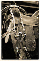 A weathered and worn saddle whispers it's storied life ...<br />